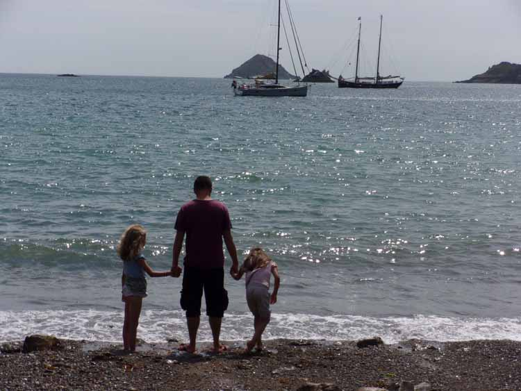 Father and daughters paddling on Sark lr
