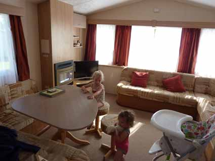 Harriett and Heidi inside The Rio static caravan lr