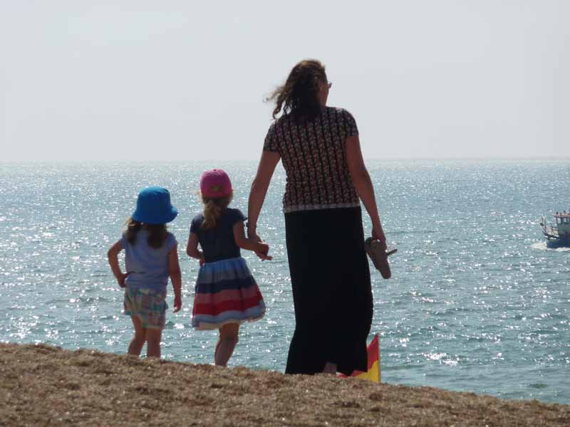Mummy and the girls at West Bay beach lr
